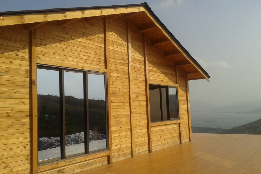 Wooden Homes Wooden Houses In India Prefab Cottages Wooden